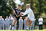 03 April 2016: Notre Dame's Nikki Ortega (3) and North Carolina's Maggie Auslander (right). The University of North Carolina Tar Heels hosted the University of Notre Dame Fighting Irish in a 2016 NCAA Division I Women's Lacrosse match. Maryland won the game 14-8.