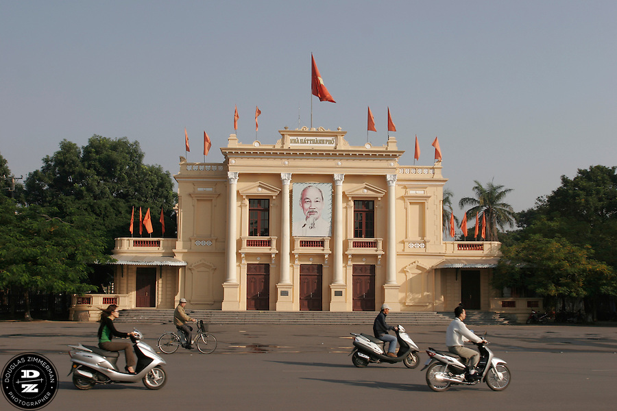 Motorbikes race past the Opera House, one of the tourist sights in Haiphong, Vietnam.  Haiphong, the third largest city in Vietnam, is an important seaport and industrial center for the country.  Photograph by Douglas ZImmerman