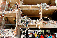 Rescue workers look for survivors in the collapsed shell of the Rana Plaza complex in Savar. The 8 storey building, which housed a number of garment factories employing over 3,000 workers, collapsed on 24 April 2013. By 29 April, at least 380 were known to have died while hundreds remained missing. Workers who were worried about going to work in the building when they noticed cracks in the walls were told not to worry by the building's owner, Mohammed Sohel Rana, who is a member of the ruling Awami League's youth front. He fled his home and tried to escape to neighbouring India after the building collapsed but was caught by police and brought back to Dhaka. Some of the factories working in the Rana Plaza building produce cheap clothes for various European retailers including Primark in the UK and Mango, a Spanish label. . /Felix Features