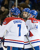 The River Hawks celebrate Budd's tying goal. - The visiting Northeastern University Huskies defeated the University of Massachusetts-Lowell River Hawks 3-2 with 14 seconds remaining in overtime on Friday, February 11, 2011, at Tsongas Arena in Lowelll, Massachusetts.