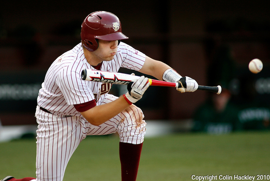 TALLAHASSEE, FLA 4/23/10-FSU-MIAMI BASE10 CH-Florida State's Parker Brunelle lays down a sacrifice bunt in the fourth inning against Miami Friday at Dick Howser Stadium in Tallahassee. The Hurricanes beat the Seminoles 6-5..COLIN HACKLEY PHOTO
