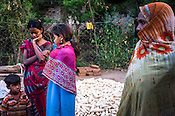 Rekha RAMESH (left) is seen with her younger sister and mother (right) in the backyard of her  house in Dhawati VIllage of Khaknar block of Burhanpur district in Madhya Pradesh, India.  Photo: Sanjit Das/Panos for ACF