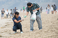 Arian Davoudian, 20, and Fay Baradi, 21, pick up trash during Heal the Bay's Coastal Cleanup Day at Santa Monica beach on Saturday, September 17, 2011.