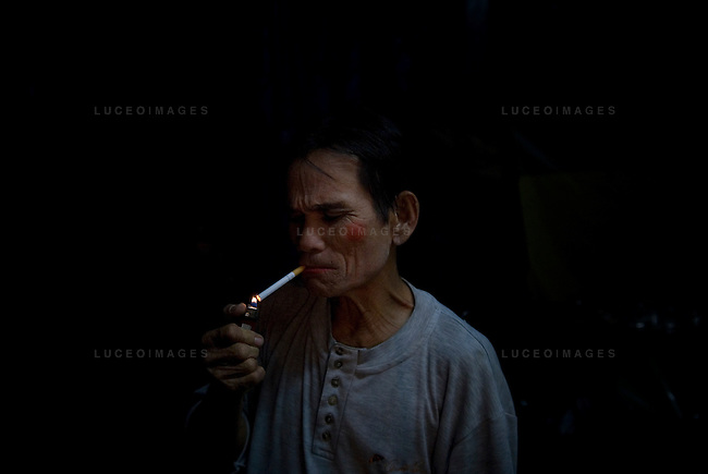 A circus performer smokes a cigarette before his act in Ho Chi Minh City, Vietnam.