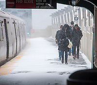 "Commuters struggle through the snow at the Smith Street-9th Street station on the elevated portion of the IND line in the Gowanus neighborhood of Brooklyn in New York during a snow storm on Tuesday, January 21, 2014. The city is expected to receive between 8 and 14 inches of snow with brutal ""Polar Express"" temperatures in the single digits. The snow will taper off by Wednesday morning but the arctic temperatures are expected to last several days.  (© Richard B. Levine)"