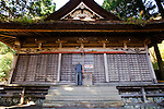 Yoshifumi Yamada, 84, chairman of Lake Shouji Touism Association, says a prayer at a shrine at the entrance of a cemetery in which the remains of unidentifiable suicide victims are interred  near Aokigahara Jukai, better known as the Mt. Fuji suicide forest, which is located at the base of Japan's famed mountain west of Tokyo, Japan on 03 Nov. 2009...