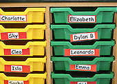 Plastic trays with children's names on, state nursery school.