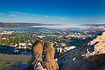 A hiker's boots and a view of the Missoula, Montana valley from Mount Sentinel