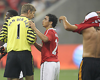 Rafael #21 of Manchester United with Edwin Van Der Sar #1 during the 2010 MLS All-Star match against the MLS All-Stars at Reliant Stadium, on July 28 2010, in Houston, Texas. Manchester United won 5-2.