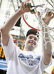 Josh Harrellson cuts down the net at the 2011 SEC Men's Basketball Tournament, played at the Georgia Dome, Sunday, March 13, 2011.  Kentucky defeated Florida 70-54.  Photo by Latara Appleby | Staff