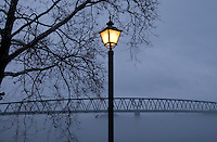 Street light cuts through fog rising above the Ohio River in Marietta, OH.