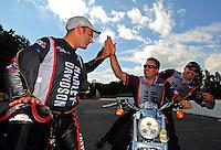 May 6, 2012; Commerce, GA, USA: NHRA pro stock motorcycle rider Eddie Krawiec (left) celebrates with crew chief Matt Hines after winning the Southern Nationals at Atlanta Dragway. Mandatory Credit: Mark J. Rebilas-