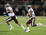 Texas A&amp;M's Tony Hurd Jr. (4) intercepts a pass against Mississippi in the final minutes as Texas A&amp;M defensive back Dustin Harris (22) blocks in Oxford, Miss. on Saturday, October 6, 2012. Texas A&amp;M won 30-27. (AP Photo/Oxford Eagle, Bruce Newman)..