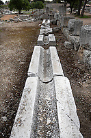 CORINTH, GREECE - APRIL 16 : A detail of an irrigation channel, on April 16, 2007 in Corinth, Greece. Corinth, founded in Neolithic times, was a major Ancient Greek city, until it was razed by the Romans in 146 BC. Rebuilt a century later it was destroyed by an earthquake in Byzantine times. (Photo by Manuel Cohen)