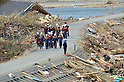 April 2nd, 2011, Rikuzentakata, Japan - A rescue party makes their way in their search-and-rescue operations in Rikuzentakata City, Iwate Prefecture, on April 2, 2011, three weeks after this Japanese coastal city was wiped out by a tsunami that followed a magnitude 9.0 earthquake. Rikuzentakata was one of the worst-hit town in the entire northeastern region. (Natsuki Sakai/AFLO) [3615] -mis-...