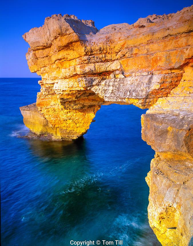 Sea arch on Crete Coast  Sea of Crete, Greece  Aeggean Sea  Limestone cliffs along North Coast  May