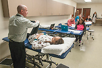 NWA Democrat-Gazette/ANTHONY REYES &bull; @NWATONYR<br /> Dr. David Taylor, Associate Professor of Physical Therapy at University of Arkansas for Medical Sciences, demonstrates testing procedures with physical therapy student Paris Richardson Thursday, Dec. 10, 2015 at the school in Fayetteville. Richardson and other students were in a lab reviewing course material for their upcoming final exams. The school is finishing its first semester in Fayetteville.