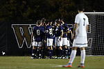 11 November 2015: Notre Dame's starters huddle as Wake Forest's Jon Bakero (ESP) (7) waits. The Wake Forest University Demon Deacons hosted the University of Notre Dame Fighting Irish at Spry Stadium in Winston-Salem, North Carolina an Atlantic Coast Conference Tournament Semifinal game and a 2015 NCAA Division I Men's Soccer match. Notre Dame won the game 1-0 and advanced to the ACC Championship final.