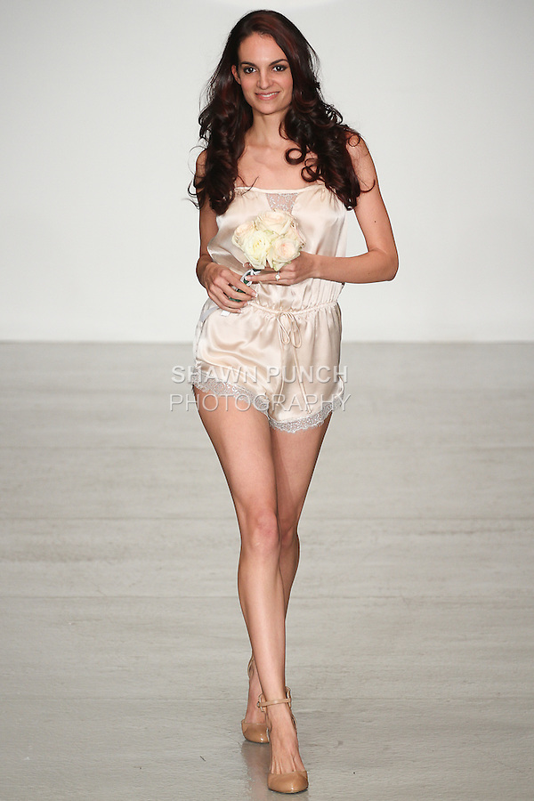 Model walks runway in lingerie from The Giving Bride Spring Summer 2015 collection by Maggie Gillette, for the Lingerie Fashion Week SS15 Official Closing Show, during LingerieFW Spring Summer 2015.