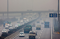 Traffic and pollution on motorway near the financial district of Xian, China
