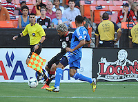 Nick DeLeon (18) of D.C. United goes against Justin Morrow (15) of the San Jose Earthquakes. D.C. United defeated the San Jose Earthquakes 1-0, at RFK Stadium, Saturday June 22 , 2013.