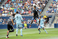 San Jose defender Steven Beltashour (33) heads the ball away from a corner... Sporting Kansas City defeated San Jose Earthquakes 2-1 at LIVESTRONG Sporting Park, Kansas City, Kansas.