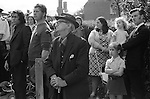 A mixed age group familes and retired and working miners. Crowds line the street to watch the Pit Banners being carried through the town. The annual Durham Miners Gala, County Durham, England 1974