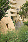 Washington DC; USA:  National Museum of the American Indian, inspiring new architecture on the Mall. Teepee and earthen oven on display outside..Photo copyright Lee Foster Photo # 12-washdc83243