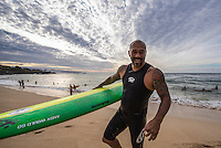 Waimea Bay, North Shore of Oahu, Hawaii.  December 4 2014) Sunny Garcia (HAW).- The Opening Ceremony of the 2014 Quiksilver In Memory of Eddie Aikau contest was held this afternoon in the park at Waimea Bay. This winter, the big wave riding event celebrates a special milestone of 30 years. <br /> The Quiksilver In Memory of Eddie Aikau is a one-day big wave riding event that only takes place if and when waves meet a 20-foot minimum height, during the holding period of December 1 through February 28, each Hawaiian winter. The official Opening Ceremony with the Aikau Family will be held on Thursday, December 4th, 3pm, at Waimea Bay.<br />  <br /> &quot;The Eddie&quot; is the original big wave riding event and stands as the measure for every big wave event that exists in the world today. It has become an icon of surfing through its honor, integrity and rarity.<br />  <br /> The event honors Hawaiian hero Eddie Aikau, whose legacy is the respect he held for the ocean; his concern for the safety of all who entered it on his watch; and the way with which he rode Waimea Bay on its most giant and memorable days. <br />  <br /> Adherence to strict wave height standards has ensured its integrity; it is only held on days when waves meet or exceed the Hawaiian 20-foot minimum (wave face heights of approximately 40 feet). This was the threshold at which Eddie enjoyed to ride the Bay. It has been said that what makes The Eddie special is the times it doesn't run, because that is precisely its guarantee of integrity and quality days of giant surf.<br />  <br /> The competition has only been held a total of 8 times: it's inaugural year at Sunset Beach, and then seven more times at its permanent home of Waimea Bay. The Eddie was last held on December 9, 2009, won by California's Greg Long.   Photo: joliphotos.com