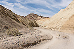 Death Valley National Park, California; views of the multi-colored rock formations seen while walking in the Golden Canyon Trail in late morning sunlight and shadows