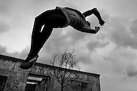 Jose Rodriguez, a parkour athlete from Plus Parkour team, does a back flip as he practices his acrobatics skills during a training exercise in Bogotá, Colombia, 22 February 2016. Parkour, originally developed in France during the late 1980s from military training, is a physical activity, focused on the art of movement and overcoming obstacles in a strictly urban environment. Practitioners of parkour employ running, climbing, jumping, rolling and other movements to pass through any urban area the most efficient way possible.