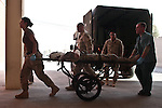 A U.S. soldier wounded in a Taliban bomb explosion is wheeled into the trauma room at NATO's Role 3 hospital at Kandahar Airfield, Afghanistan. Sept. 28, 2010. DREW BROWN/STARS AND STRIPES