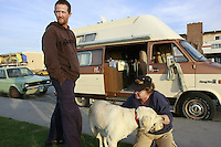 A man who gave his name as David, stands next to the camper van that he lives in with his girlfriend Vickie and their dog Isis in Ocean Beach, Thursday January 31 2008.  David and Vickie were both born deaf and both survive on welfare.  Until David bought the van for $350, they lived on the street.  San Diego City Council are studying the cost of a ban on overnight parking of RVs in coastal neighborhoods.