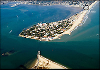 BNPS.co.uk (01202 558833)<br /> Pic: PHT/BNPS<br /> <br /> The famous Sandbanks peninsula in Poole.<br /> <br /> Plans to transform the millionaire's resort of Sandbanks into 'Britain's Miami Beach' with two new superhotel's and apartments as part of a &pound;250m development have been unveiled. <br /> <br /> A pair of century-old hotels on the exclusive Dorset peninsula will be bulldozed to make way for an extravagant five star hotel on the beach and a smaller hotel with apartments on the cliffs above.<br /> <br /> The luxurious 175 room establishment will replace the existing Sandbanks Hotel, a former Victorian seaside villa built in the 1880s that is now 'coming to the end of its economic life cycle.'<br /> <br /> In keeping with the Miami Beach look, the super hotel will be Art-Deco in style, have curved floors and painted white with palm trees in the grounds.<br /> <br /> The existing historic Harbour Heights Hotel will also be demolished to make way for the second part of the radical development.