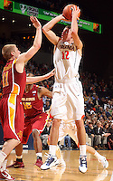 Dec. 30, 2010; Charlottesville, VA, USA; Virginia Cavaliers guard Joe Harris (12) shoots over Iowa State Cyclones guard Scott Christopherson (11) during the game at the John Paul Jones Arena. Iowa State Cyclones won 60-47. Mandatory Credit: Andrew Shurtleff