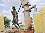 A boy obtains water for his family at a well installed by the United Methodist Committee on Relief (UMCOR) in Yei, a town in Central Equatoria State in Southern Sudan.