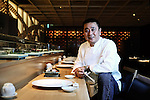 World-renowned Japanese chef Nobu Matsuhisa sits at the counter at his restaurant in central Tokyo, Japan. ROB GILHOOLY