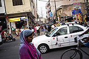 Local residents seen at a busy intersection in Mahipalpur in New Delhi, India. Photo: Sanjit Das/Panos