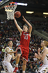 Davidson's Peyton Aldridge (23) goes to the basket between Iowa's Jarrod Uthoff (20) and Mike Gesell (10)  during 2015 NCAA Division I Men's Basketball Championship March 20, 2015 at the Key Arena in Seattle, Washington.  Iowa beat Davidson 83-52.   ©2015. Jim Bryant Photo. ALL RIGHTS RESERVED.
