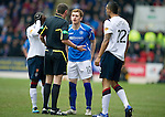 St Johnstone v Rangers...14.01.12  .Ref Craig Thomson warns Sone Aluko, Liam Craig and Kyle Bartley.Picture by Graeme Hart..Copyright Perthshire Picture Agency.Tel: 01738 623350  Mobile: 07990 594431