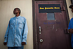 SAN QUENTIN, CA - APRIL 30, 2014: San Quentin News design editor Bonaru Richardson takes a break outside their newsroom. CREDIT: Max Whittaker for The New York Times