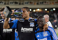 "Ryan Johnson ""drinks"" from the Sacramento Cup. The San Jose Earthquakes defeated Chivas USA 6-5 in shootout after drawing 0-0 in regulation time to win the inagural Sacramento Cup at Raley Field in Sacramento, California on June 12, 2010."