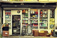 A cluttered, small convenience store on Newark Avenue in Jersey City, New Jersey.
