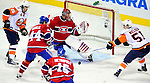 26 October 2009: Montreal Canadiens' goaltender Jaroslav Halak watches the puck rebound off the goalpost in the third period against the New York Islanders at the Bell Centre in Montreal, Quebec, Canada. The Canadiens defeated the Islanders 3-2 in sudden death overtime for their 4th consecutive win. Mandatory Credit: Ed Wolfstein Photo