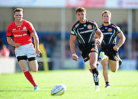 Chris Ashton of Saracens and Henry Slade of Exeter Chiefs chase after the ball. Aviva Premiership match, between Exeter Chiefs and Saracens on September 11, 2016 at Sandy Park in Exeter, England. Photo by: Patrick Khachfe / JMP