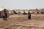 DOMIZ, IRAQ: Syrian refugees walk through the Domiz refugee camp...Over 7,000 Syrian Kurds have fled the violence in Syria and are living in the Domiz refugee camp in the semi-autonomous region of Iraqi Kurdistan...Photo by Ari Jalal/Metrography