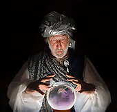 Swami gazing into a crystal ball