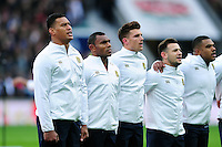 Nathan Hughes, Semesa Rokoduguni and Henry Slade of England sing the national anthem. Old Mutual Wealth Series International match between England and Fiji on November 19, 2016 at Twickenham Stadium in London, England. Photo by: Patrick Khachfe / Onside Images