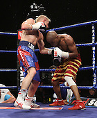 Gary Sykes (Dewsbury, blue shorts) defeats Harry Ramogoadi (Rugby, red/gold shorts) in a Super-Featherweight contest at Goresbrook Leisure Centre, Dagenham, Essex promoted by Frank Maloney / FTM Sports - 18/07/08 - MANDATORY CREDIT: Gavin Ellis/TGSPHOTO - Self billing applies where appropriate - Tel: 0845 094 6026.