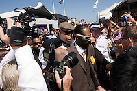 Rapper Snoop Dogg dodging the media throng at the 2008 Melbourne Cup race day.